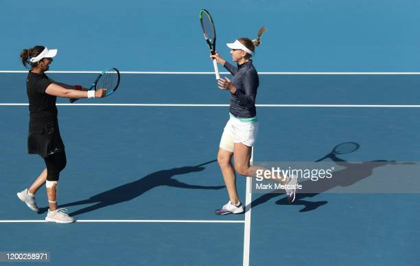 Nadiia Kichenok of Ukraine and Sania Mirza of India celebrate winning match point during their final doubles match against Zhang Shuai and Shuai Peng...