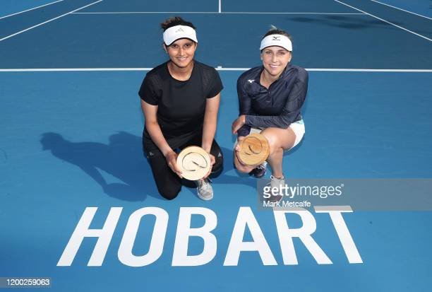 Nadiia Kichenok of Ukraine and Sania Mirza of India pose after winning their final doubles match against Zhang Shuai and Shuai Peng of China during...