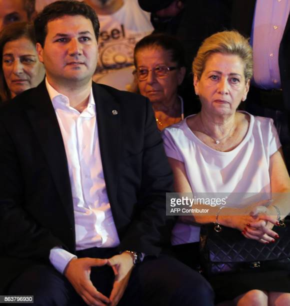 Nadim and Solange Gemayel son and widow of Lebanese presidentelect Bashir Gemayel attend a demonstration in the Christian neighborhood of Achrafieh...