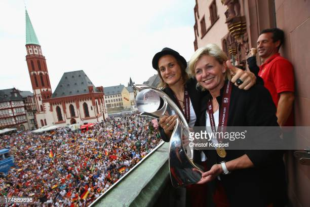 Nadine Angerer and head coach Silvia Neid celebrate winning the UEFA Women's EURO 2013 on the balcony of the Roemer on July 29 2013 in Frankfurt am...