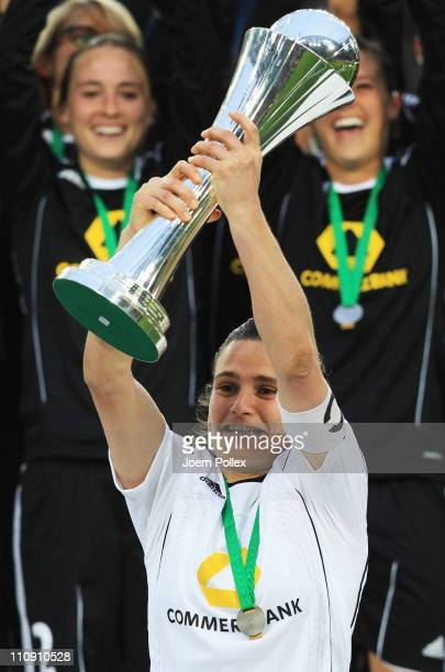 Nadine Angerer and the team of Frankfurt celebrate with the cup after winning the DFB Women's Cup final match between 1 FFC Frankfurt and Turbine...