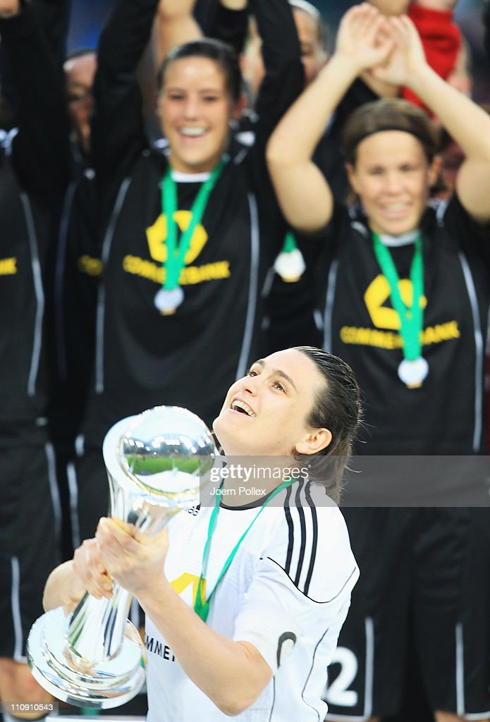 Nadine Angerer and the team of Frankfurt celebrate with the cup after winning the DFB Women's Cup final match between 1. FFC Frankfurt and Turbine Potsdam at RheinEnergie stadium on March 26, 2011 in Cologne, Germany.