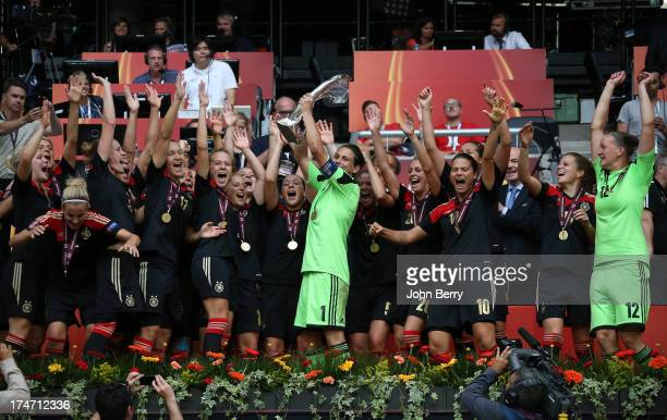 Nadine Angerer goalkeeper and captain of Germany celebrates the victory with her teammates during the trophy ceremony after the UEFA Women's Euro...
