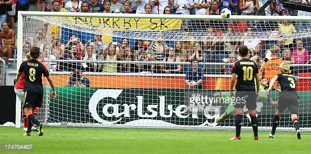 Nadine Angerer , goalkeeper of Germany saves the penalty shot of Solveig Gulbrandsen of Norway during the UEFA Women's EURO 2013 final match between...