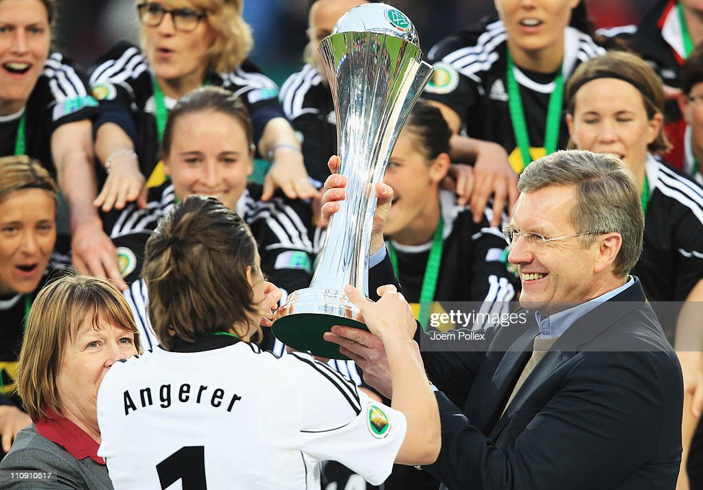 Nadine Angerer of Frankfurt gets the cup from german president Christian Wulff after the DFB Women's Cup final match between 1. FFC Frankfurt and Turbine Potsdam at RheinEnergie stadium on March 26, 2011 in Cologne, Germany.