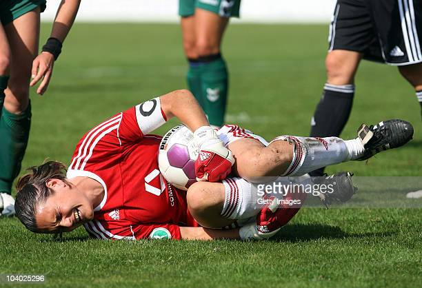 Nadine Angerer of Frankfurt lies injured on the pitch during the Women's bundesliga match between FCR Duisburg and FFC Frankfurt at the PCCStadium on...