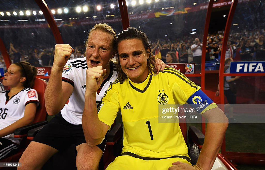 Nadine Angerer of Germany celebrates with Melanie Behringer after the quarter final match of the FIFA Women's World Cup between Germany and France at Olympic Stadium on June 26, 2015 in Montreal, Canada.