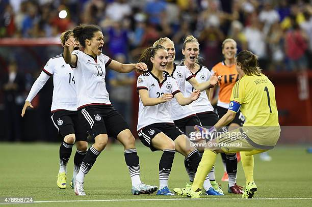Nadine Angerer of Germany celebrates with team mates as she saves the final penalty during the FIFA Women's World Cup Canada 2015 Quarter Final match...