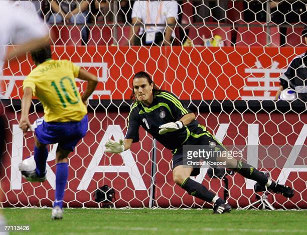 Nadine Angerer of Germany dives to save the penalty of Marta of Brazil during the Women's World Cup 2007 Final match between Brazil and Germany at...