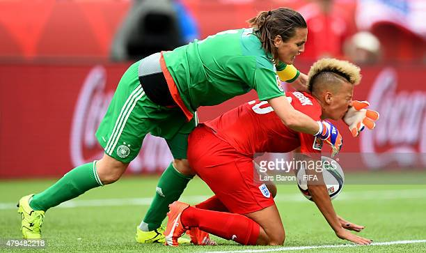 Nadine Angerer of Germany is challenged by Lianne Sanderson of England during the FIFA Women's World Cup 2015 Third Place Playoff match between...