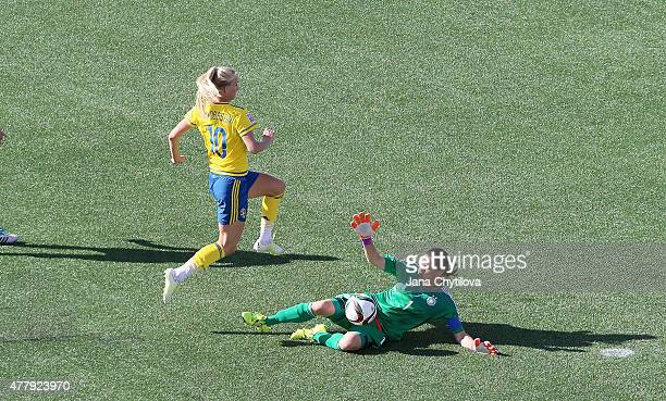 Nadine Angerer of Germany makes a diving save on a break away by Sofia Jakobsson of Sweden in the second half during the FIFA Women's World Cup...