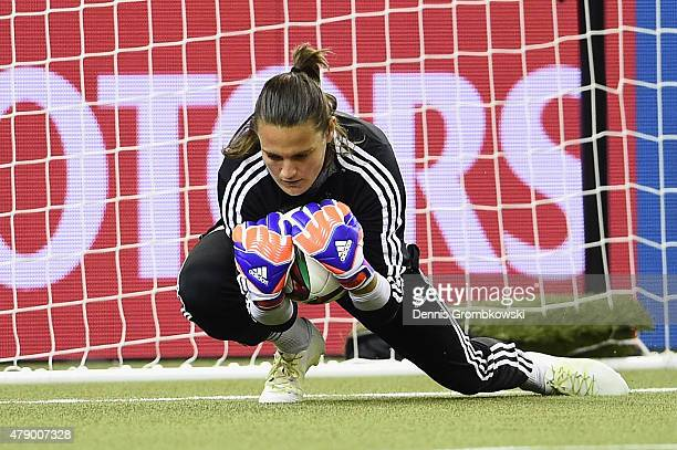 Nadine Angerer of Germany makes a save during a training session at Olympic Stadium ahead of their semi final match against the United States on June...