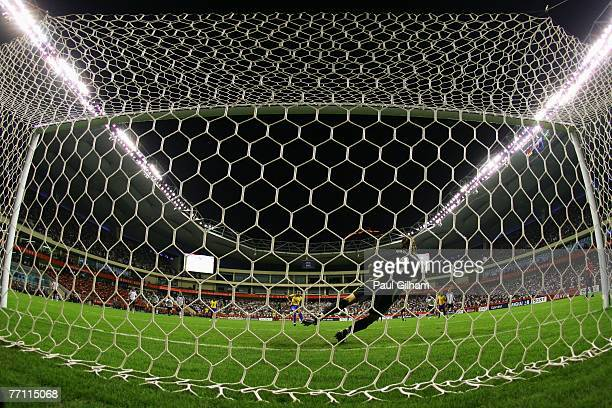 Nadine Angerer of Germany saves a penalty from Marta Vieira Da Silva of Brazil during the Women's World Cup 2007 Final between Brazil and Germany at...