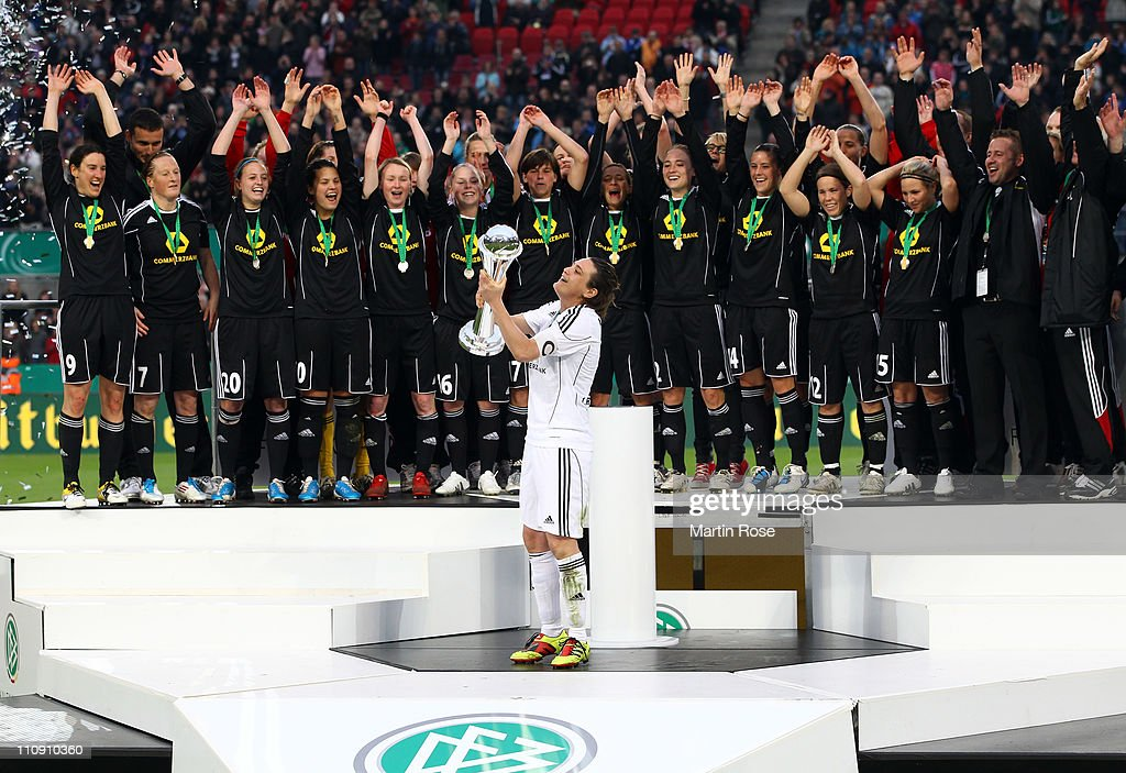 Nadine Angerer, team captain of Frankfurt lifts the trophy after winning the DFB Women's Cup final match between 1. FFC Frankfurt and Turbine Potsdam at RheinEnergie stadium on March 26, 2011 in Cologne, Germany.