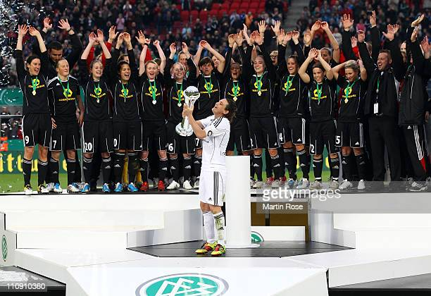 Nadine Angerer team captain of Frankfurt lifts the trophy after winning the DFB Women's Cup final match between 1 FFC Frankfurt and Turbine Potsdam...