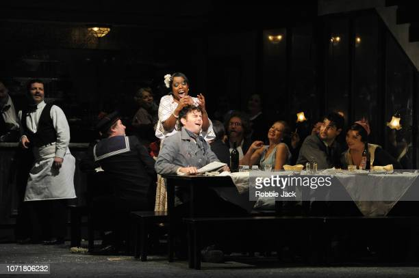 Nadine Benjamin as Musetta Nicholas Lester as Marcello Jonathan Tetelman as Rodolfo and Natalya Romaniw as Mimi with artists of the company in...