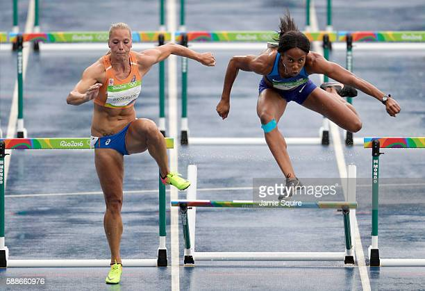 Nadine Broersen of the Netherlands and Barbara Nwaba of the United States compete in Women's Heptathlon 100 Meter Hurdles on Day 7 of the Rio 2016...