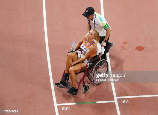 Nadine Broersen of the Netherlands is helped into a wheel chair after the Women's Heptathlon 800 Metres during day seven of 17th IAAF World Athletics...