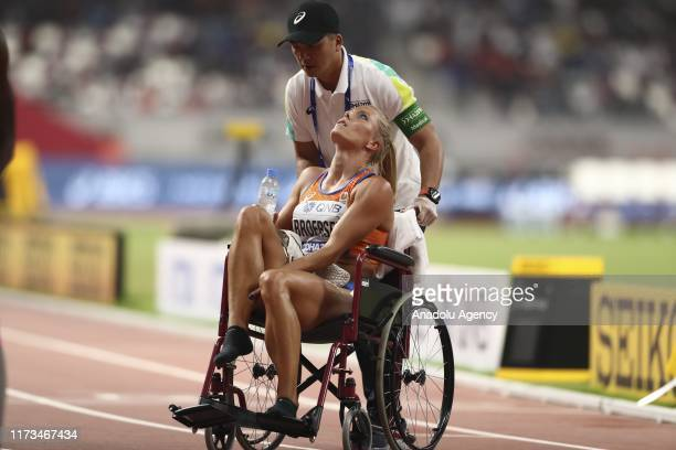 Nadine Brosersen of Netherlands is seen at wheelchair after competing in Women's 800m heptathlon final race during the 17th IAAF World Athletics...