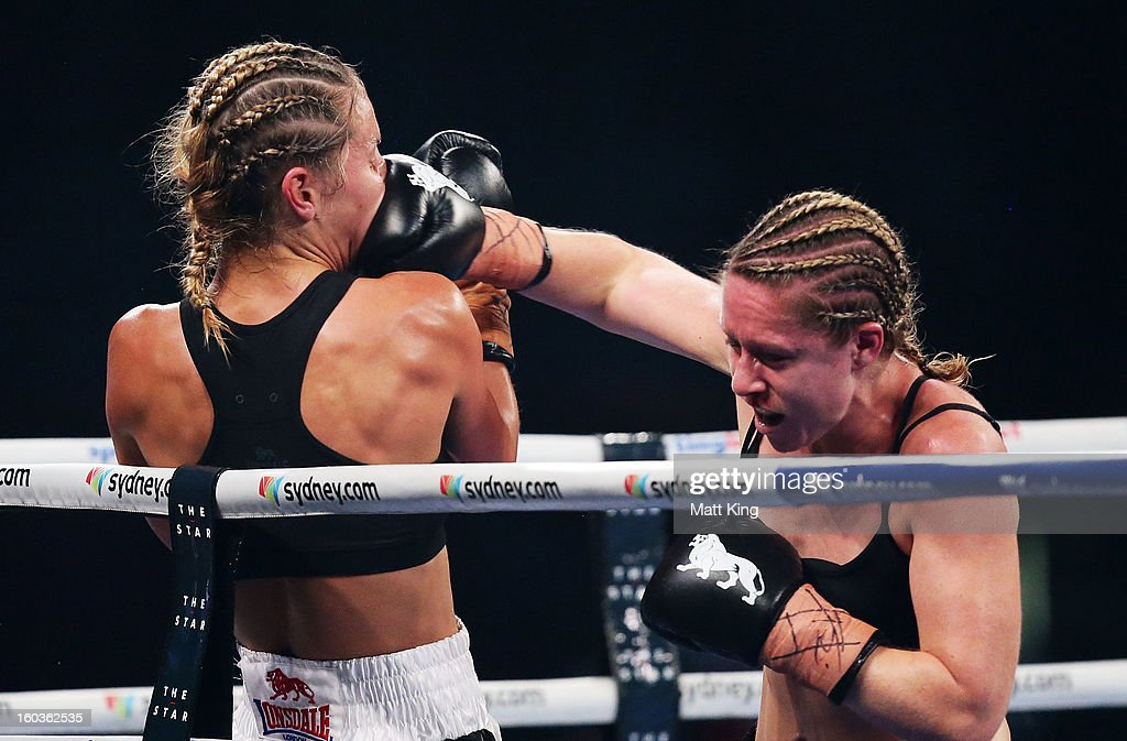 Nadine Browne (R) lands a right hook on Lauryn Eagle (L) during the Australian Female Lightweight Title bout at Sydney Entertainment Centre on January 30, 2013 in Sydney, Australia.