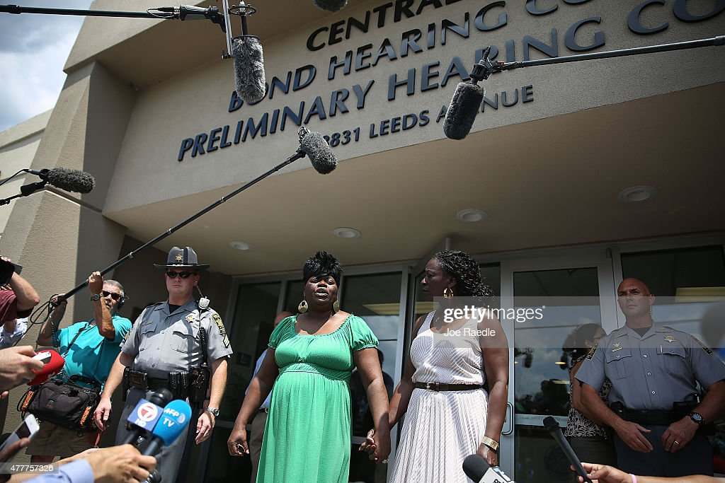 Nadine Collier (L) speaks to the media outside of the Centralized Bond Hearing Court Preliminary Hearing Court where she attended the bond hearing for Dylann Roof who is accused of killing her mother, Ethel Lance, and nine others during a shooting at the Emanuel African Methodist Episcopal Church on June 19, 2015 Charleston, South Carolina. Dylann Roof, 21, is suspected of killing nine people during a prayer meeting in the church, which is one of the nation's oldest black churches in Charleston.