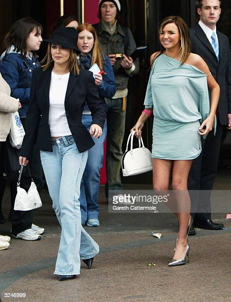 Nadine Coyle and Cheryl Tweedy of Girls Aloud leave the Capital FM Awards April 7, 2004 at the Lancaster Gate Hotel in London.
