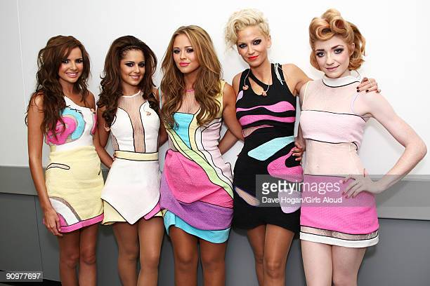 Nadine Coyle Cheryl Cole Kimberley Walsh Sarah Harding and Nicola Roberts of Girls Aloud pose backstage at Wembley Stadium before performing as part...