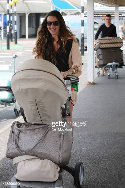 Nadine Coyle seen arriving back at Heathrow Airport from Los Angeles with her daughter Anaiya on August 14 2014 in London England Nadine has come...