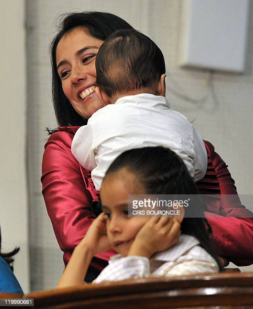 Nadine Heredia wife of President-elect Ollanta Humala attends the swearing-in ceremony of her husband next to her daughter Nayra while she holds...