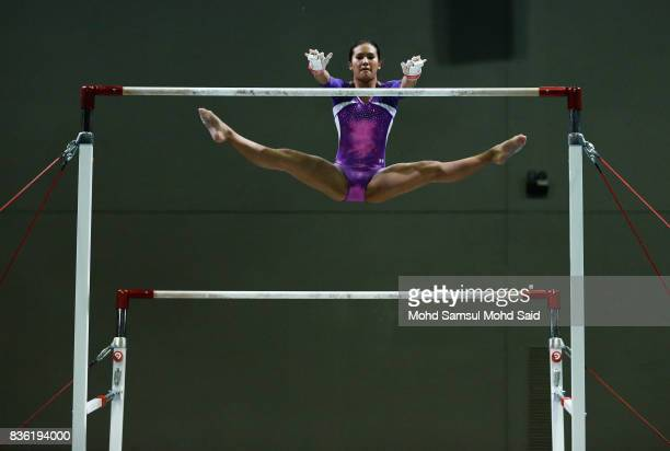 Nadine Joy Nathan of Singapore competes in the team artistic gymnastic Uneven Bars event qualifications team final during the 29th Southeast Asian...
