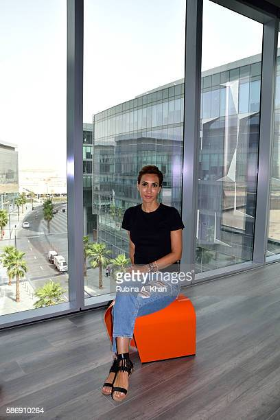 Nadine Kanso a Lebanese born Dubaibased jewelry designer wearing jewellery from her Bil Arabi line in her office at Dubai Design District on August 7...