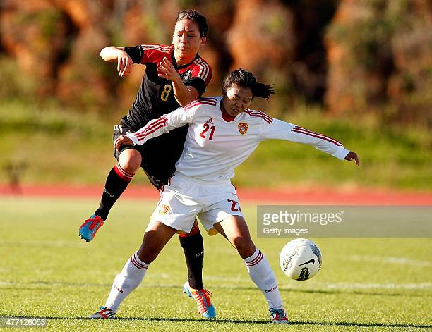 Nadine Kessler of Germany challenges Wang Lisi of China during the Algarve Cup 2014 match between Germany and China on March 07, 2014 in Albufeira,...