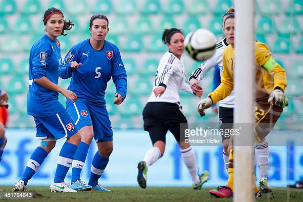 Nadine Kessler of Germany scores past goalkeeper Maria Korenciova of Slovakia during the FIFA Women's World Cup 2015 Qualifier between Slovakia and...