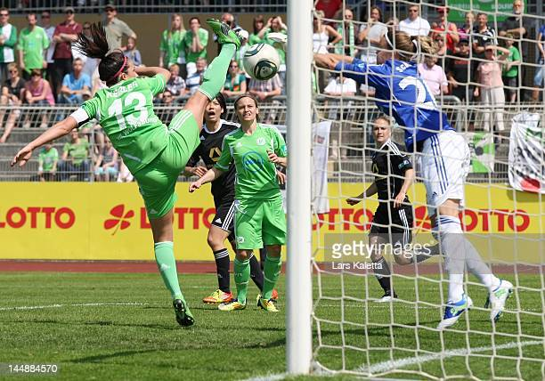 Nadine Kessler of VfL Wolfsburg and goalkeeper Desiree Schumann of 1 FFC Frankfurt vie for the ball during the Women's Bundesliga match between VfL...