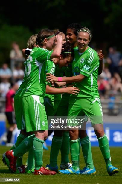 Nadine Kessler of Wolfsburg celebrates with teammates after scoring her team's first goal during the Women's Bundesliga match between SG...