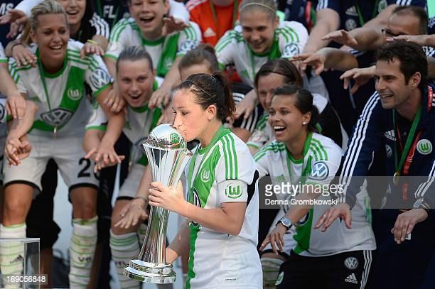 Nadine Kessler of Wolfsburg kisses the trophy after winning the Women's DFB Cup Final between VfL Wolfsburg and 1 FFC Turbine Potsdam at Rhein...