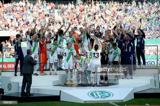 Nadine Kessler of Wolfsburg lifts the trophy after winning the Women's DFB Cup Final between VfL Wolfsburg and 1 FFC Turbine Potsdam at Rhein Energie...