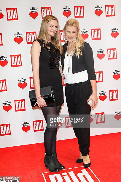Nadine Krueger and guest attend the Ein Herz fuer Kinder Gala 2014 at Tempelhof Airport on December 6 2014 in Berlin Germany