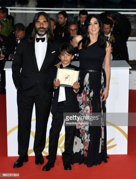 Nadine Labaki poses with Khaled Mouzanar and Zain Alrafeea during the Award Winners photocall after she won the Jury Prize for 'Capharnaum' at the...
