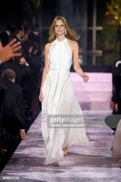 Nadine Leopold wearing Elie Saab walks the runway at the amfAR Gala Cannes 2018 at Hotel du CapEdenRoc on May 17 2018 in Cap d'Antibes France