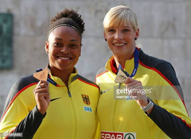 Nadine Mueller of Germany silver and Shanice Craft of Germany bronze pose with their medals for the Women's Discus Throw during day six of the 24th...