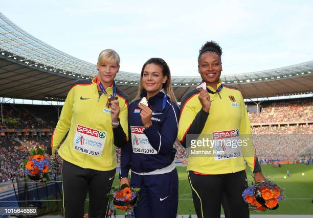 Nadine Mueller of Germany silver Sandra Perkovic of Croatia gold and Shanice Craft of Germany bronze pose with their medals for the Women's Discus...