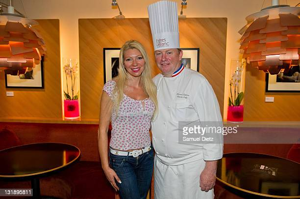 Nadine Rodd and Bernard Leprince pose at the Studio Harcourt exhibition at Copenhague Restaurant on May 30 2011 in Paris France
