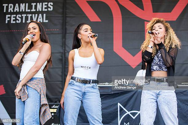 Nadine Samuels Annie Ashcroft and Frankie Connolly of MO perform on stage at Tramlines Festival at Devonshire Green on July 26 2014 in Sheffield...