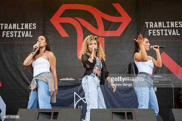 Nadine Samuels Frankie Connolly and Annie Ashcroft of MO perform on stage at Tramlines Festival at Devonshire Green on July 26 2014 in Sheffield...