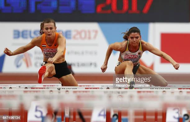 Nadine Visser of Netherlands and Pamela Dutkiewicz of Germany compete in the Women's 60 metres hurdles semi finals on day one of the 2017 European...