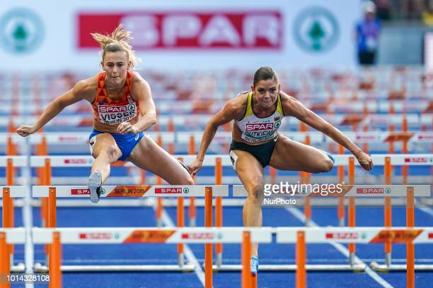 Nadine Visser of  Netherlands and Pamela Dutkiewicz of  Germany during 100 meter hurdles semifinal for women at the Olympic Stadium in Berlin at the...