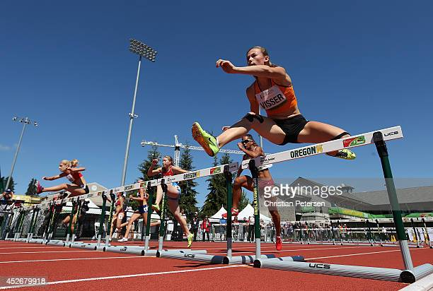 Nadine Visser of Netherlands competes in the women's 100m hurdles heats during day four of the IAAF World Junior Championships at Hayward Field on...