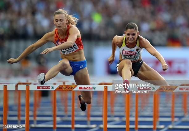 Nadine Visser of the Netherlands and Pamela Dutkiewicz of Germany compete in the Women's 100 metres hurdles semi finals during day three of the 24th...