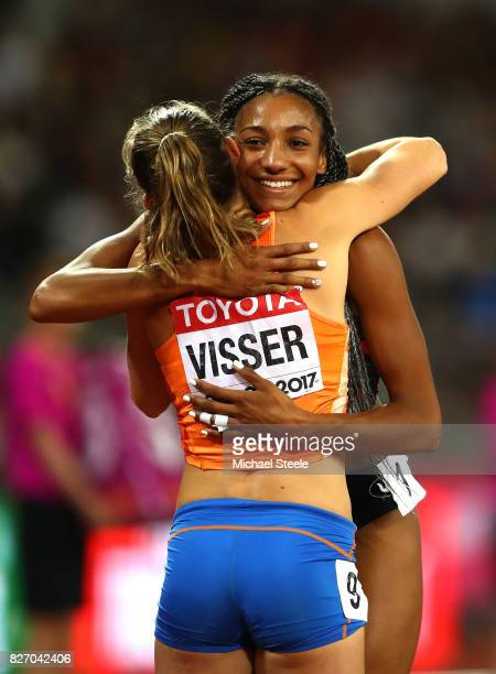 Nadine Visser of the Netherlands hugs Nafissatou Thiam of Belgium celebrates after the Women's Heptathlon 800 metres and Thiam winning gold in the...
